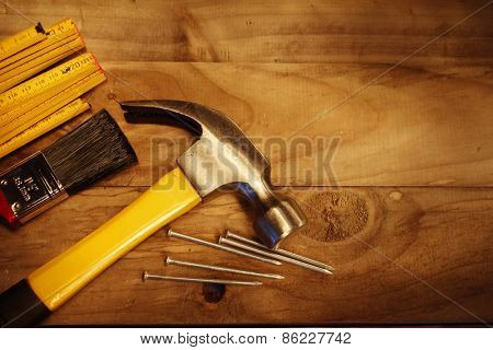 Hammer, nails, ruler and brush