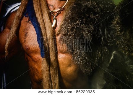 Close Up Torso Of A Strong Man With A Skin On His Shoulder