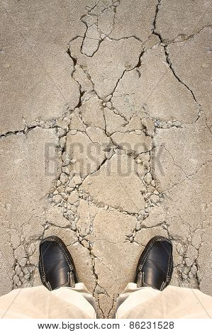 A Man Standing On Crack Ground