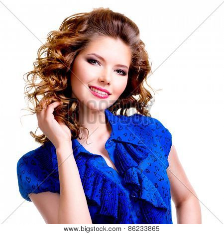 Portrait of beautiful happy smiling woman in blue dress with hand near face - isolated on a white background.