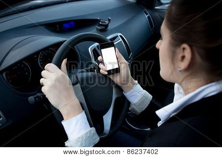 Closeup Photo Of Woman Using Smartphone While Driving A Car