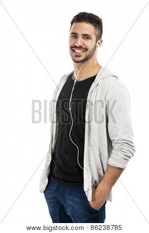 Portrait of latin man smiling and listen music
