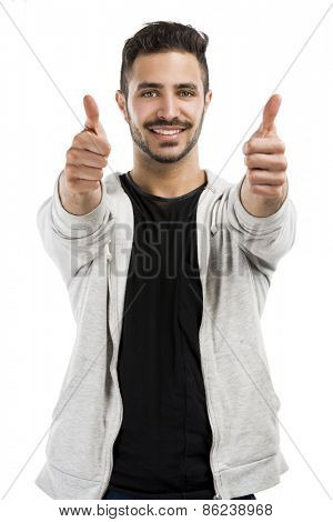 Beautiful and happy man smiling with thumbs up