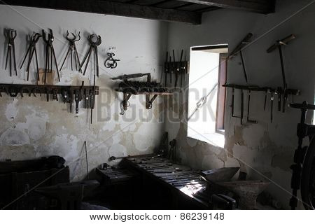 KUMROVEC, CROATIA - SEPTEMBER 24: blacksmith's workshop in Ethnological Folk Museum Staro Selo in Kumrovec, Northern County of Zagorje Croatia on September 24, 2013.