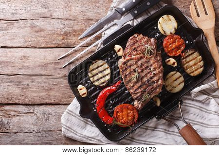 Grilled Beef Steak With Vegetables In Pan. Horizontal Top View