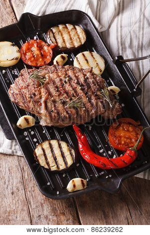 Beef Steak Grilled With Onions, Eggplant And Chilli In Pan Grill
