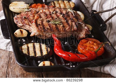 Tasty Beef Steak With Vegetables On A Grill Pan. Horizontal.