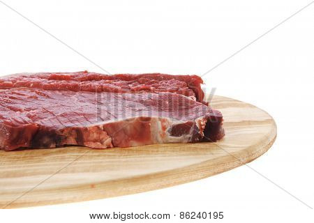 fresh raw beef steak fillet on wood isolated over white background