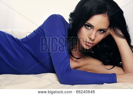 Sexy Woman With Dark Hair Wearing Elegant Blue Dress
