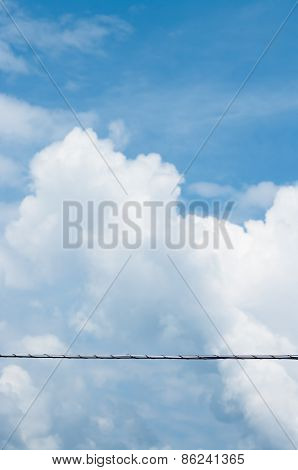 Electrical High Voltage Line On A Clouds Background