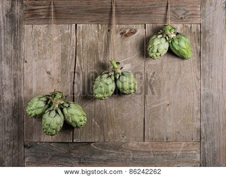 Artichokes On Aged Wooden Background
