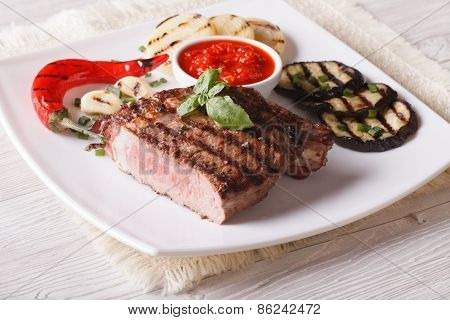 Beef Steak, Grilled Vegetables And Sauce Close-up. Horizontal