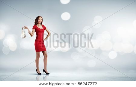 Woman in red dress against bokeh background