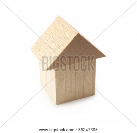 Wooden home or house isolated on white.
