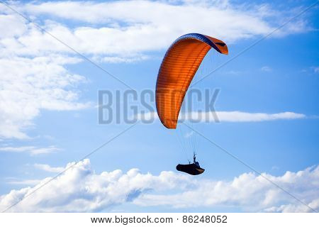 Paraglider Flying On Blue Sky