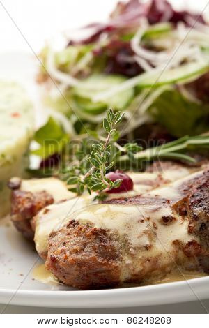 Grilled Pork with Mushed Potato and Raw Vegetables