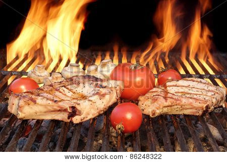 Two Steaks And Vegetables Char-grilled Over Flaming Bbq Grill