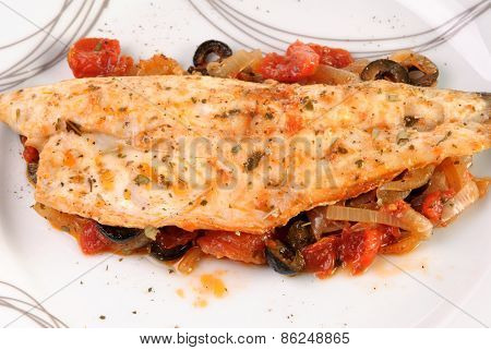 White Fish Fillet With Onion, Tomatoes And Black Olives