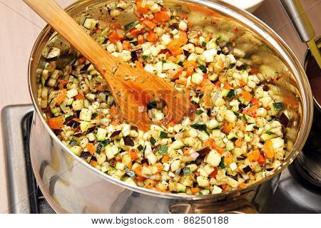 Vegetables Cooking In A Pan On Stove