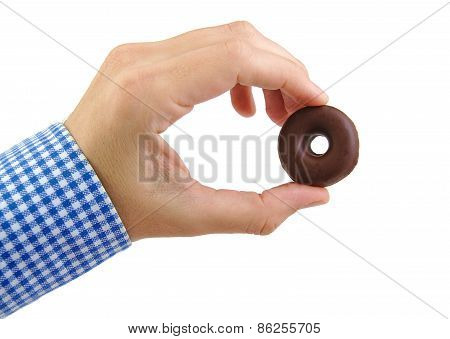 Man hand holding a chocolate donut cookie isolated on white background