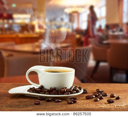 Cup Of Hot Coffee On Table In Cafe