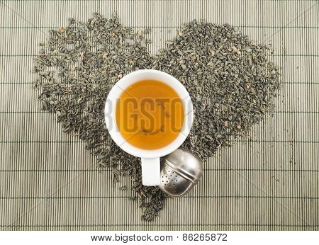 Black tea heart shape top view