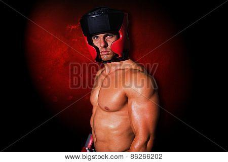 Muscular boxer against dark background