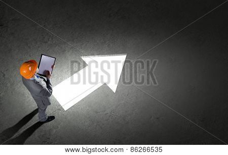 Top view of businessman and business sketches on floor