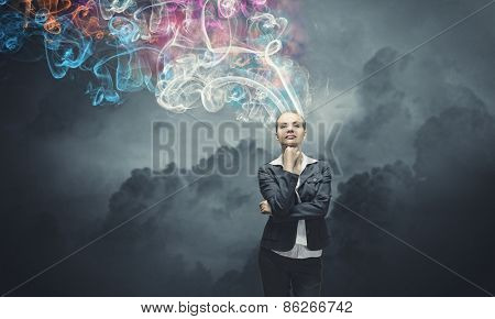 Thoughtful businesswoman with colorful fumes above head