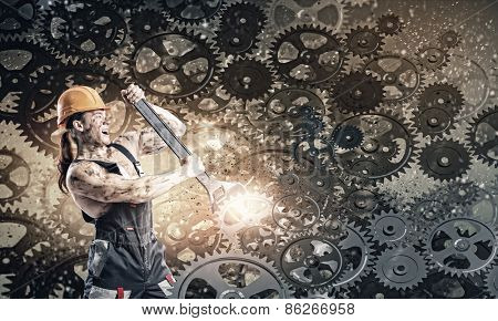 Strong man mechanic in uniform with spanner fixing mechanism