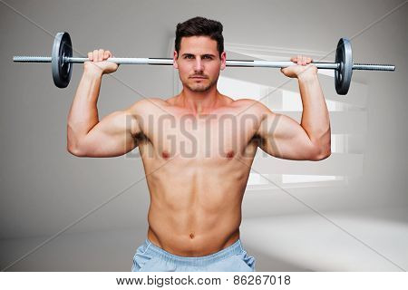 Bodybuilder lifting barbell against digitally generated room with bordered up window