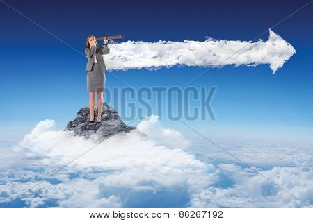 Businesswoman looking through a telescope against cloud arrow