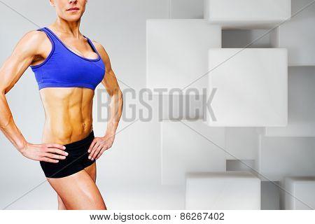 Female bodybuilder against white tile design