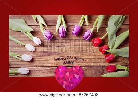 happy mothers day against tulips on table