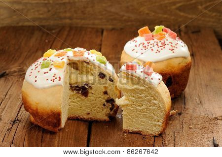 Kulich, Russian Easter Yeast Sweet Bread Decorated With Icing, Cut,on Wooden Background