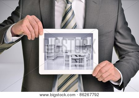 Man holding internet tablet. Kitchen in tablet screen. Gray background