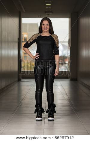 Fashion Girl Wearing Leather Pants And Long Sleeve