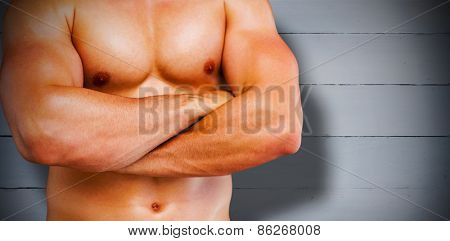 Bodybuilder against painted blue wooden planks