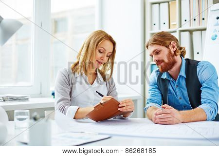 Woman assigning tasks for man