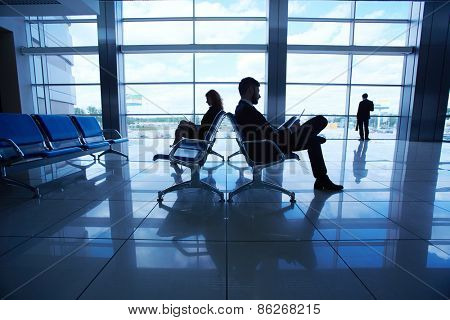 Business travelers waiting for their departure in airport