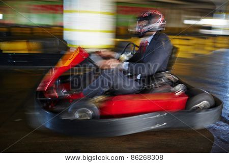 Brave businessman racing in go-kart