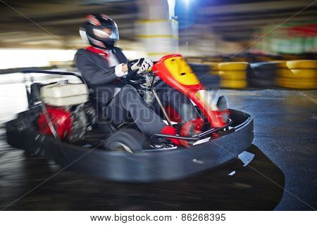 Businessman enjoying kart racing