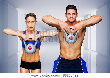 Bodybuilding couple against digitally generated room