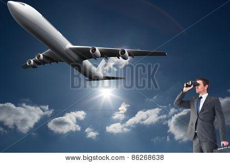 Businessman looking through binoculars against sky