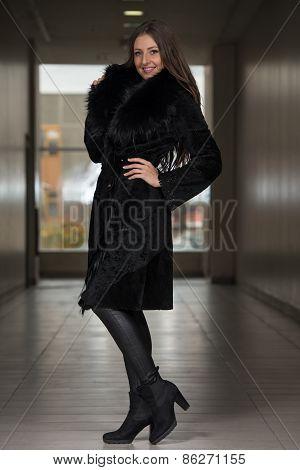 Elegant Lady In White Long Fur Coat