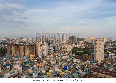 Poor Houses In Ho Chi Minh Riverside Cityscape View With B