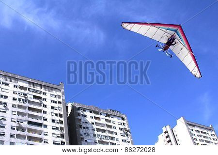 Hang Glider Over Buildings