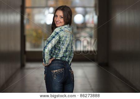 Glamour Fashion Model Wearing Blue Pants And Shirt