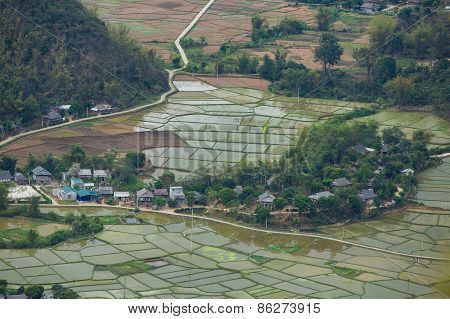 Small House In The Rice Fields At Mai Chau Village , Hoa Binh, Vietnam. Water Is Fill Up For New Sea