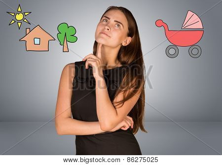 Business woman thinking over buggy and house with tree